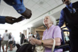 76 year-old Marie Hlavaty (cq) shows her documents to a TSA employee, as she prepares to go...