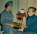 Leanora Francis as a volunteer 40 years ago at Fitzsimons Army Medical Center delivering...