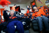 Sporting their favorite Broncos gear, Sister Marie Paula Hardy, left, (cq with pom pom), and...