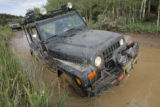 As the lead vehicle, DU Off-Road Club President Peter Belsky (cq) moves slowly through a water...