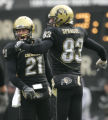 0204 University of Colorado Scotty McKnight, left and Dusty Sprague celebrate late first quarter...