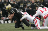 0615 University of Colorado Jordon Dizon, left, recovers a blocked put as they beat the University...