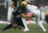 Ricky Thenarse blocks Taj Kaynor after Cu blocked a punt in the third quarter of CU against...