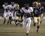 Douglas County's Jose Astorga out runs Mullen defenders Mario for a 82 yard touchdown run to put...