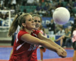 Tonya Arnold, Hoehne High School, bumps the ball, while teammate Nicole Paradisa, back, looks on,...