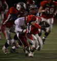 Jordan Delbaugh, #44, Heritage, is pulled down from behind in the second quarter of play against...