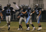 Ralston Valley's team celebrates after #32 Lee Marshall interception of a pass in the 4th quarter...