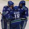 Vancouver, B.C.  11/09/07 Vancouver Canuck #33 Henrik Sedin celebrates his goal with his linemates...