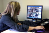 Klare Looney (cq) , owner of Lightway Daycare in Edgewater watches the live video feed of the...