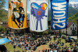 TELLURIDE, CO -- Banners hang above the crowd that formed in Elks park at the Telluride Film...