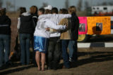 Friends gather at the scene of a fatal crash Sunday Nov. 25, 2006 after four teenagers were in a...