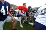 [Golden, CO - Shot on: 9/22/04] School of Mines Quarter back Chad Friehave(CQ) attends a...