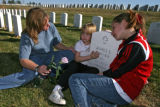 DM0768   Tracey Murphy and her daughters Morgan, 5, and Ashley, 13, visit the grave of Tracey's...