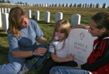 DM0769   Tracey Murphy and her daughters Morgan, 5, and Ashley, 13, visit the grave of Tracey's...