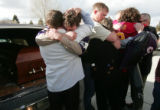 Close friends and family hug  outside the Sheridan Elemetary School in  Sheridan,  Montana  Sunday...
