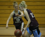 Cassie Lambrecht, point guard for Golden HS's basketball practices with teammate Samantha Neal in...
