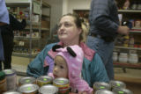 McKenna McPhail, 2, foreground and her grandmother, Lisa Post (cq), check out after doing some...