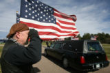Bruce Hannen (cq) salutes, as the remains of Major John L. Carroll, arrives at the cemetery,...