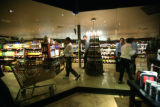 Customers shop in the liquor and wine area on the opening day of Safeway store in LIttleton, Colo....