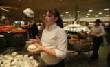 Hannah Smith, (cq) 13 from Highlands Ranch juggles mozzarella balls in the vegetable section on...