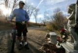 Randy Small from Edgewater stops at  a  memorial for Neveah Gallegos along the Lakewood Gulch bike...