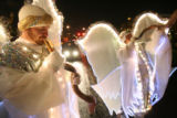 (DLM2056) -   Todd Ness, left,  wait with the other angels for the start of the Parade of Lights...