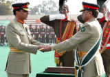 Pervez Musharraf, right,  Pakistan's president, presents the change of command baton to the newly...