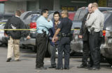 Denver Police talk with a witness near the Ha Noi  restaurant at 1036 S. Federal Blvd. Wednesday...