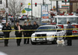 CSI and members of the Denver Police investigate the scene of a shooting on November 14th,...