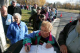 Senior citizens line up for free boxes of food at the Arvada Community Food Bank Wednesday 14,...