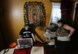 (from left) Three generations of hispanics share the living-room of 25 year-old Marisol Bolanos....