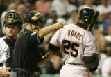 [(Denver, CO,Shot on: 9/8/04)] Home Plate Umpire Mike Reilly directs San Francisco Giants Barry...