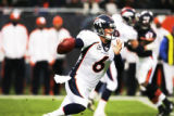[EPS101]  Denver Broncos quarterback Jay Cutler  runs for a  in the first quarter of play at...