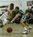 Doherty's Daniel McConkie, right, makes a steal from East Hight School's DaVaughn Thornton in...