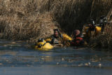 Emergency personal recover  a young female adult who fell through the ice at a pond at the Buffalo...