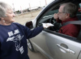 Kathy Kubitz (cq), who works with Jim Sullivan, of Big Jim's Ribs mobil van in Parker, brings out...