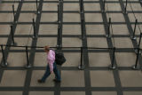 DM2705   A passenger walks past the empty security lines on the south side of the main terminal at...