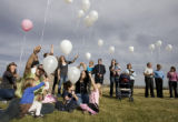 DM3007   Balloons are released into the sky over Clement Park as friends and family of Nonnie...