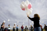 DM2967   Sharon Pszanka hands out balloons to the friends and family of Nonnie Dotson so they can...