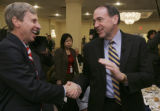 NHJC101 - Republican Presidential hopeful, former Arkansas Gov. Mike Huckabee, right, shakes hands...