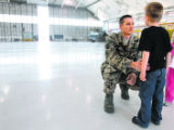 DM0274   Tech Sgt. Steve has a man to man talk with his son Joshua as families say good-bye to...
