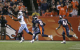 0434  Tennessee Titans #86 Roydell Williams drops a Vince Young pass with Denver Broncos #21 Hamza...