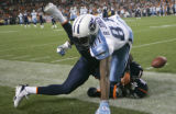 0520 Denver Broncos Hamza Abdullah breaks up a pass to Tennessee Titans Brandon Jones in the first...