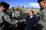 DM3211   With tears in her eyes Judi Fermanich thanks and shakes hands with Pfc. Nathan Trusty,...