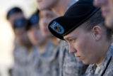 DM3217   Pvt. Juliana Hartzell, 23, bows her head as she stands in formation with members of her...