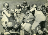 (Needs ID) Four distinguished individuals and the 1954 football team were inducted to the...