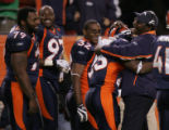 [JOE1020]  Denver Broncos Andre Hall is hugged by running back coach Bobby Turner, right, after...