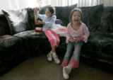 0117 With a sense of enthusiasm, Janae Cashman, 8, CQ, left, and Angel Troncosa, 5, right, open...