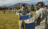 Lt Col. Troy Otto, middle, and CSM Gerald Kinloch, right, roll up the flag for the 3rd Special...