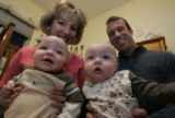 Kathy and Rich Peters hold their 6 month old twins Ryan, left and Ava,  in their nursery November...